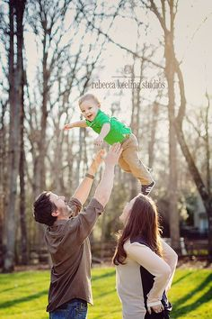 2 year old photo. Fun with daddy. Family pic. Tossing in the air.