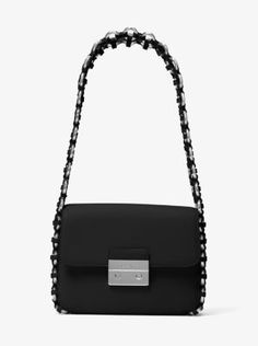 Elegant yet with a touch of city edge, our Piper handbag is crafted from polished leather and finished with a woven leather-and-chain-link shoulder strap. This structured silhouette delivers modern glamour to both daytime and evening affairs.