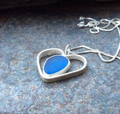 Sea glass jewelry,  Open back bezel set cornflower blue sea glass heart necklace by FatCatsOnTheBeach on Etsy https://www.etsy.com/listing/242561757/sea-glass-jewelry-open-back-bezel-set