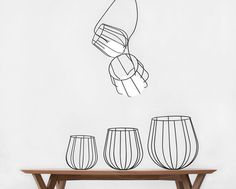 martin azua suspends dipping metallic basket in light container