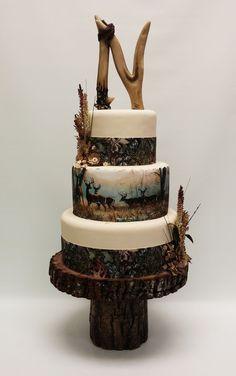 Hunting theme wedding cake with a deer horn monogram. #CamoWeddingIdeas