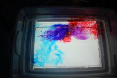 Lava Lamp in a box! (clear tupperware on top of light table, liquid watercolor, oil, eyedroppers)