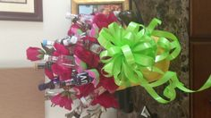 Birthday gift for a friend. Twenty-one different, mini liquor bottles, mini cupcake papers, styrofoam, hot glue, floral wire (tripled), and cheap flowers. Wha-la!
