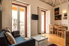 Entire home/apt in Porto, Portugal. Located in a renewed building of the XIX century, this beautiful mezzanine studio with balcony of offers you an interesting experience of bein. Lofts For Rent, Places Around The World, Great Places, Balcony, Portugal, Living Room, Studio, Building, Modern