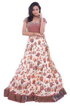 Look fashionable by wearing this multicolor Pure Raw Silk Lehenga with Net Dupatta. This beautiful Lehenga is adorned with digital floral print and sequined border. The dupatta with sequins work adds a zing to this attire.