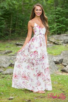 This maxi dress is perfect for summer romance and fun! Featuring a floral pattern in pink, purple, and green on a white background, this dress is perfect for warmer weather! It has an open back, a v-neckline, and super light fabric. For additional comfort, there's also a zipper on the left side and adjustable spaghetti straps.