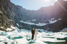 Bride and Groom holding hands while standing on an iceberg! Iceberg Lake, Glacier National Park www.jacilynm.com