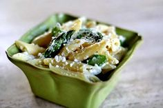 Penne with ricotta and asparagus.  Simple spring pasta with asparagus, ricotta and Parmesan cheeses, garlic, and a dash of nutmeg.