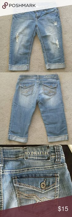 """Hydraulic Distressed Jean Capris All frays pictured are how the jeans were made. But there is pen on the inside if one leg as shown in the last picture. Other than that excellent condition.  Measurements laying flat- Length 24"""" Waist 16.5"""" stretches to 18"""" Inseam 16"""" Rise 8""""  #Denim #cuffed #cuff #kneeknockers #clamdiggers #lightwash #5pocket #jeans #goeswitheverything #holiday #vacation #spring #summer #fall #winter #anytime #fray #distressed Hydraulic Pants Capris"""