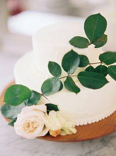 simple white wedding cake with flowers @weddingchicks