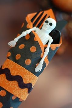 Halloween napkins - use paper, this would be the start of a cute take-home favor (add some candy, etc.)