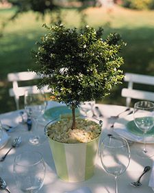 Turn kids' metal beach buckets into custom centerpieces by painting them in the wedding colors.