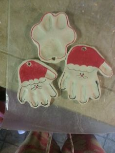 Santa handprint ornaments with sculpey clay and paw print
