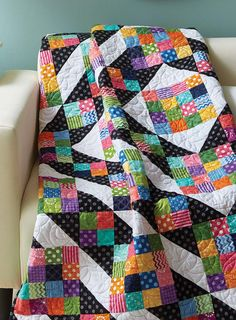 Pair bright, large prints with a black print to create movement in this creative throw. Strip sets enable you to make the Sixteen Patch units quickly. About This Quilt Finished Size: 56″ x 64″ Rating: Intermediate Designed by: Love of Quilting Staff