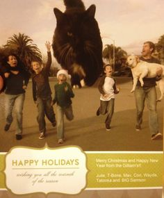 Quite scary Christmas card - funny card with family running from a giant cat
