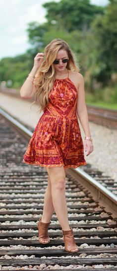 Casual boho outfit styled with a bold pattern backless dress, brown peep toebooties, round Ray Ban sunglasses