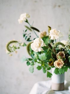 cream and champagne colored flowers contrasted against bold greens, beautiful wedding palette.