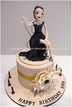 Glamour Woman Birthday Cake by Elite Cake Designs.  Exclusive birthday cake design featuring a glamour woman figurine in a gorgeous outfit. Ideal for a 30th, 40th and even a 50th birthday!  Figurine can be customised with your basic characteristics and preferred outfit