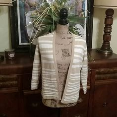 Casual open sweater top Glittery sweater top. Worn twice. Good condition. Not sure what the size is but fits a size 4-8 respectfully. Chico's Jackets & Coats