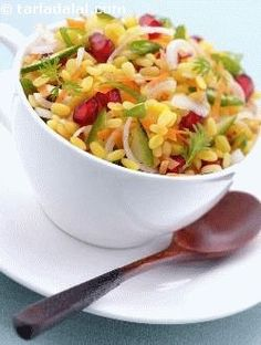 Moong Dal Ki Chaat Calorie Snacks) Suggested serving size for 100 calories: 1 serving a healthy and tasty, nutritious and flavourful snack indeed. Pomegranate and raw mangoes perk up this colourful chaat. Healthy Indian Recipes, Indian Snacks, Veg Recipes, Vegetarian Recipes, Snack Recipes, Cooking Recipes, Mango Recipes, Party Recipes, Gourmet