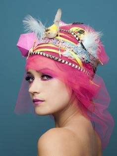 Animals by Photographer Josefina Mogrovejo...I call pretty girl in crazy pink hat!