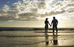Couple in backlight near sea