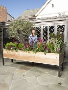Elevated Cedar Garden | Gardeners Supply Website, tall enough so you don't have to bend down to garden, has a false plywood bottom with holes for drainage