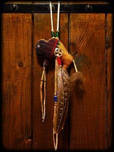 Beaded buffalo amulet