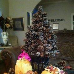 Pine cones are plentiful in the fall and winter seasons; so, take advantage and create these unique homemade Christmas decorations. These Pine Cone Trees are a great DIY craft to start off the holiday season. Pine Cone Tree, Cone Trees, Pine Cone Christmas Tree, Christmas Greenery, Nature Crafts, Fall Crafts, Christmas Crafts, Christmas Decorations, Christmas Ideas