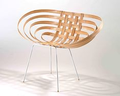 This chair is an exploration of the natural curvature of wood, and its interaction with the human body. The shell is constructed of 5 strips of ash, soaked and then bent on a free form jig. The jig dictates a seating surface and a back, connected by two …