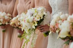 Cascade bouquets are making a comeback! Milwaukee Wedding Photography in Downtown Milwaukee Pier Wisconsin! Frphoto