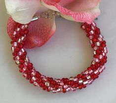 """Kumihimo Beaded Bracelet hand beaded with Czech Glass Beads in Ruby, Pink and Clear Seed Beads - By Pamela Baker of """"Magdalene Jewels"""" Kumihimo Bracelet, Beaded Bracelets, Beaded Jewelry, Christmas Countdown, Christmas 2019, Christmas Shopping, Fibres, Czech Glass Beads, How To Make Beads"""