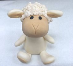 This adorable lamb is just waiting to find a home on top of your cake! Perfect for baby showers or baptisms!  Topper is approximately 4 inches high.  This topper is made from modeling fondant. Please keep your item covered and stored in a cool area to avoid any changes in color and shape.  We customize cake toppers for all occasions, so if you have any special ideas whether for a wedding, birthday, baptism, baby shower, etc. let us know and we would love to create it for you! Looking for an…