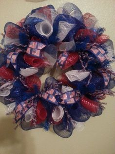 Welcome your guest for Memorial Day, July 4th and Labor Day with this red, white & blue deco mesh wreath with flag ribbon and deco tubing detail!
