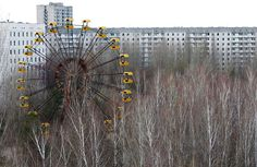 Ferris Wheel in front of abandoned apartment buildings, Pripyat, Ukraine.