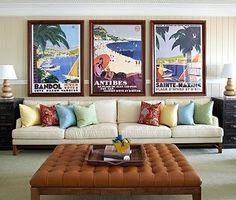 Vintage coastal art hanging over a large sofa and a symmetrical design