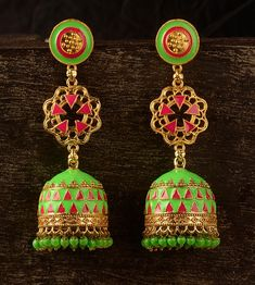 The combination of parrot green & rouge pink is always a hit! Let this ornate pair of #tribalearrings be the only accessory with your ethnic outfits & rock that minimal chic look. #TuskNHammers #TNH #traditionaljewelry #jewelry #indian #traditional #ethnicjewelry #stylish