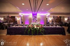 Purple rosette linen for a beautiful and striking head table at your wedding - Steve Lee Photography - Posh Petal - Over The Top Linen - Houston, Texas