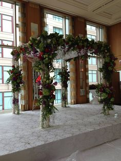 Artquest, Ltd chuppah design at the Peninsula Hotel, Chicago.   Check us out on Facebook and Instagram at artquestltd for more!