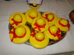 Adorable Madeline cookies made simply from store bought cookies dipped in yellow candy coating and a red ribbon tied with fruit rollups.