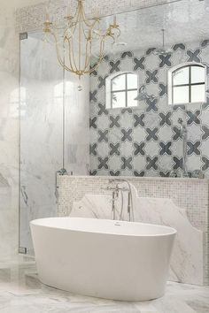 Freestanding tub in luxury bathroom with Meraki White Carrara Bardiglio Marble Tiles. #bathroomdesign #freestanding #bathtub #luxurybath