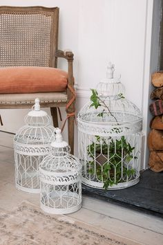 These vintage birdcages provide a wonderful shabby chic charm.
