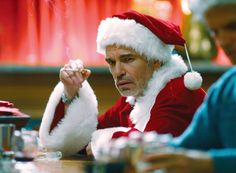 """""""I've always had a thing for Santa Claus. In case you didn't notice. It's like some deep-seeded childhood thing.""""  Lauren Graham flirts with the Claus in Bad Santa (2003).  The best ever Christmas movie quotes"""