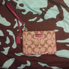 Coach wristlet with cranberry accent colors NEVER USED wristlet! Coach Bags Clutches & Wristlets