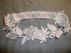 Floral Venise Lace Garter    Lovely white, delicate lace garter. This garter can be made to any size (please leave a note of thigh size at