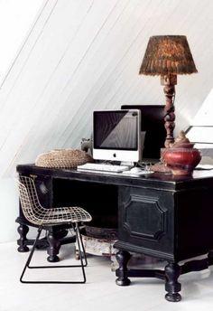 Love the heavy dark desk and light modern chair.