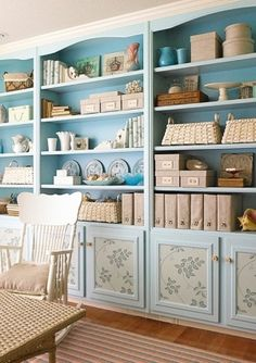 Use wallpaper inserts trimmed with molding to dress up bland or dated cabinet fronts. To update a boring built-in, first apply colorful paint. Next add flair to the cabinet fronts by attaching decorative wallpaper in coordinating colors. Finish by framing Workspaces Design, Armoire Buffet, Cabinet Fronts, Cabinet Doors, Bookcase Styling, Bookcase Storage, Wall Storage, Home And Deco, Of Wallpaper