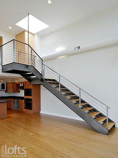 Metal staircase, wood treads and cable banister Loft Staircase, Staircases, Stairs, Ny Loft, Lofts For Rent, Luxury Loft, Banisters, Industrial Loft, New Construction