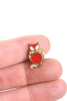 This is a cute pin of a red cat with a rhinestone bow, hhe has got rhinestones on the tail as well. It's hard enamel on a silver tone metal base. It's perfect for people who loves cats, animals or for pin collectors Very good vintage condition Vintage pins are hard to find, don't miss it  PINS OFFER: Buy 4 lapel pins and pay only 3 This is an offer for the lapel pins section and consists in buying 4 pins and pay 3 and only one shipping cost How it works? -You can tell me the pins you want…