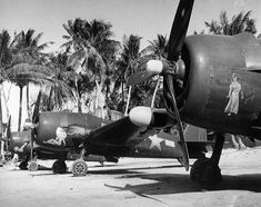 Hellcat aircraft of are on the ground at Falalop Island, Ulithi Atoll 1945 Navy Aircraft, Ww2 Aircraft, Fighter Aircraft, Aircraft Carrier, Military Aircraft, Fighter Jets, Grumman Aircraft, Grumman F6f Hellcat, Mk1